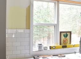 white kitchen subway tile backsplash shiplap island wood bar