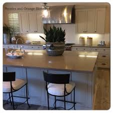 white kitchen cabinets with taupe backsplash taupe and greige and grey kitchens kitchen trends 2015