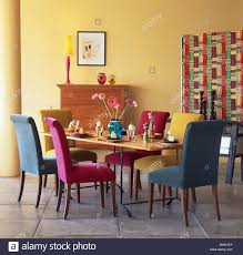 Padded Dining Room Chairs Pink Turquoise And Blue Velour Upholstered Dining Chairs At Table