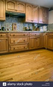 kitchen with oak cabinets u0026 wood floor and granite countertops and