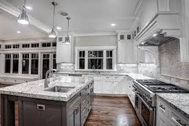 dark kitchen cabinets with light granite countertops built in cabinet doors faucet with spray curved sink white