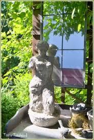 garden statue water in a flower garden with