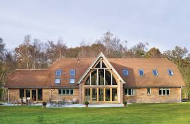 floor to ceiling double pane glass entry front of barn conversion