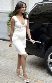 pregnant zoe saldana wears a tight white dress at the new york