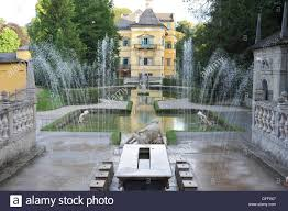 stone dining room table and ponds in the schloss hellbrunn palace stock photo stone dining room table and ponds in the schloss hellbrunn palace garden located near orzg south salzburg s district austria