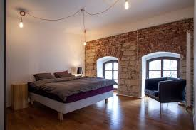 modern cornlofts triplex reconstruction by b2 architecture architecture modern vintage bedroom design with exposed stone and brick wall ideas laminate wooden floor