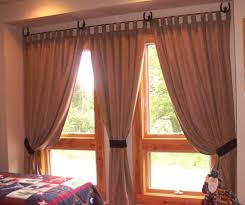 modern warm nuance of the bedroom drapes with toppers that can be