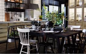 tips for a modern swedish kitchen a big dark wood dining table with lots of chairs in the middle of a modern