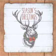 seasons greetings deer wood sign a cottage in the city