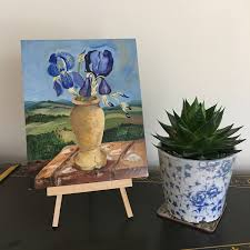 tuscany with blue iris flowers in tuscan ceramic vase original