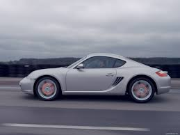 porsche side view porsche cayman s production on road a side view cars grey