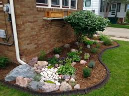 rain rock garden feature utilizes water from downspout gardening