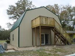 garage brown metal barns with living quarters with black roof for