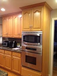 painting oak cabinets white before and after painting oak kitchen cabinets