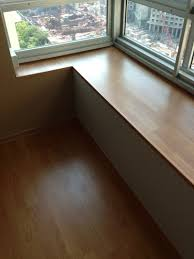vohringer laminate wood planks installed at bay windows