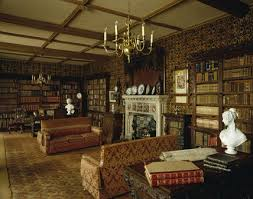 view towards the fireplace in library in victorian style with