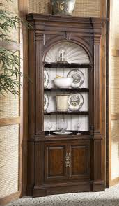 stunning dark brown polished dining corner cabinet with artwork