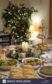 christmas party table set with candle and luxury food stock photo