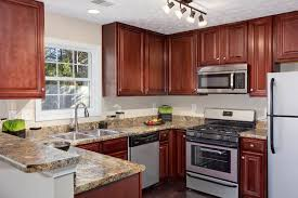 Where To Put Knobs On Kitchen Cabinets by Kitchen Cabinet Colonial White Granite With Dark Cabinets