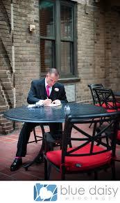 groom writing letter to bride on wedding day rockefeller center
