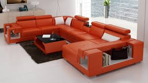furniture orange leather sectional sofa with black furry rug and