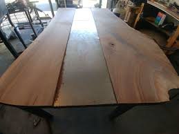 metal table with live wood edge and wall bench 16 steps with