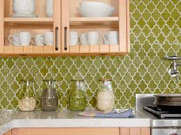 cheap kitchen backsplash made from green moroccan patterned tiles
