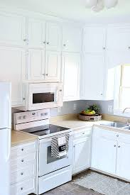 how to paint stained kitchen cabinets white painting kitchen cabinets white noting grace