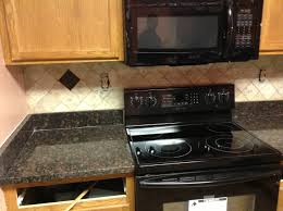 granite countertop metal frame kitchen cabinets backsplash