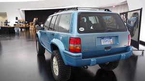 jeep grand cherokee vinyl wrap jeep restomods a grand cherokee and rods a wrangler for moab