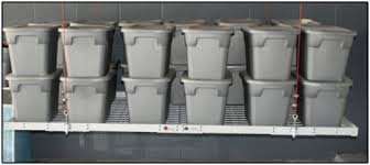 Garage Ceiling Storage Systems by Overhead Garage Racks And Motorized Garage Storage Systems In