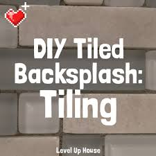 easy to install kitchen backsplash diy kitchen backsplash part 4 installing backsplash tiles