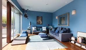 blue accent wall living room with blue accent wall and large glass window as well
