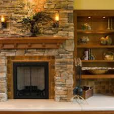 Wooden Mantel Shelf Designs by Brown Wooden Shelves And Stone Fireplace With Brown Wooden Mantel