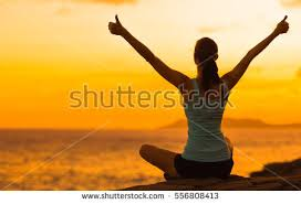 healthy celebrating during beautiful sunset stock photo