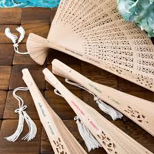 intricately carved personalized sandalwood fan favors from