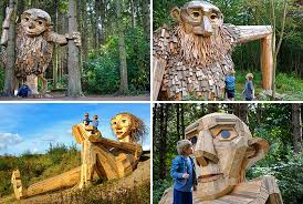 large wood sculpture six large wood giants are now hiding out in a forest near
