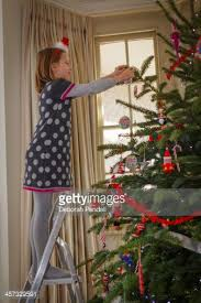 Decorative Christmas Tree Ladders by Up A Ladder Decorating Christmas Tree Stock Photo Getty Images