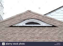 eyebrow dormer windows show the architecture of an old house stock