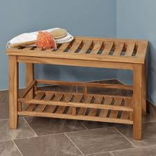 rectangle brown teak shower bench with shelf on grey tile floor