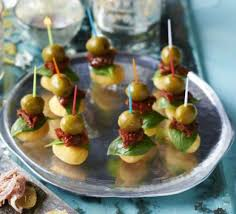 simple vegetarian canapes roasted gnocchi sundried tomato olive stacks recipe food