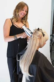 laser hair extensions hairdreams simplifies extensions application news modern salon