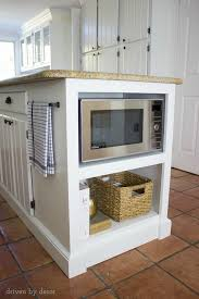 our remodeled kitchen island with built in microwave shelf