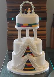 wedding wishes of gloucestershire lego wedding cake with wafer paper flowers and edible lego figures