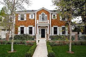 colonial style front doors shingled colonial style home with portico balcony transitional