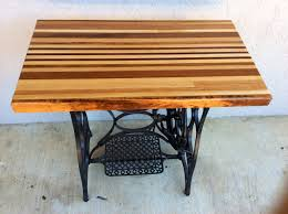refurbished 1920s new home sewing machine butcher block table on