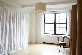 bedroom interior grey white bedroom divider curtains aside