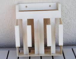 rubbermaid wall mount draw organizer aluminum foil saran wrap wax