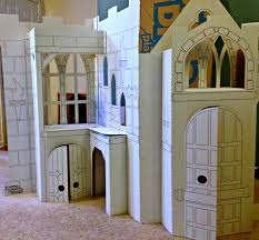 white wooden castle playhouse with door and window connected by