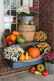 fall porch decor with plants and pumpkins great display for